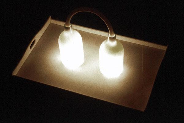 sedia rielaborata con lampade, bottiglia luminosa in scatola di legno, tempera su carta. installazione completa cm. 250x250